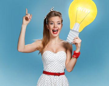 woman showing light bulb banner looking happy excited